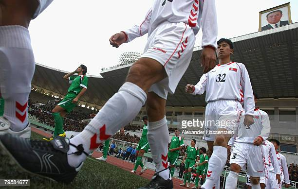 Players of the DPR Korean National Football team and the Iraq team enter the field prior the Beijing Olympic 2008 quailfier match at the Kim Il Sung...