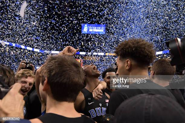Players of the Duke Blue Devils celebrate following their 7569 victory against the Notre Dame Fighting Irish during the ACC Basketball Tournament...