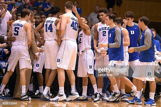 Players of the Duke Blue Devils huddle by their bench during a stop in play against the Long Beach State 49ers at Cameron Indoor Stadium on December...