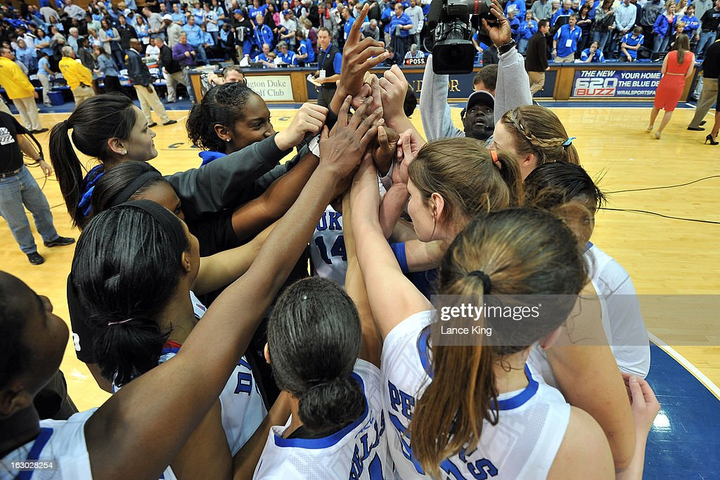 Players of the Duke Blue Devils huddle following their game against the North Carolina Tar Heels at Cameron Indoor Stadium on March 3, 2013 in Durham, North Carolina. Duke defeated North Carolina 65-58.