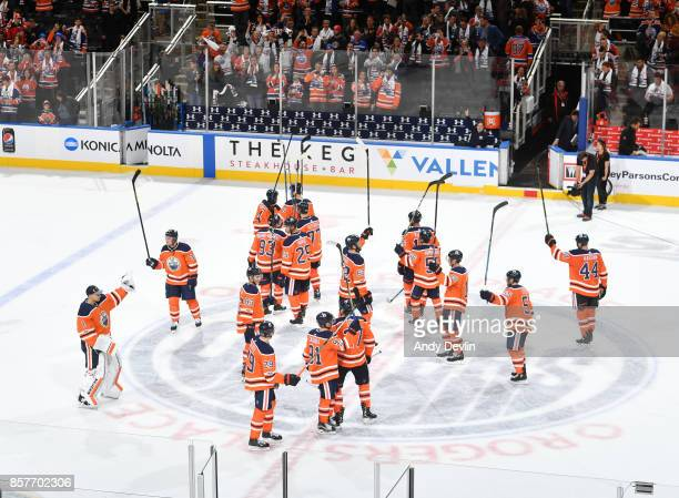 Players of the Edmonton Oilers salute the crowed following the game against the Calgary Flames on October 4 2017 at Rogers Place in Edmonton Alberta...