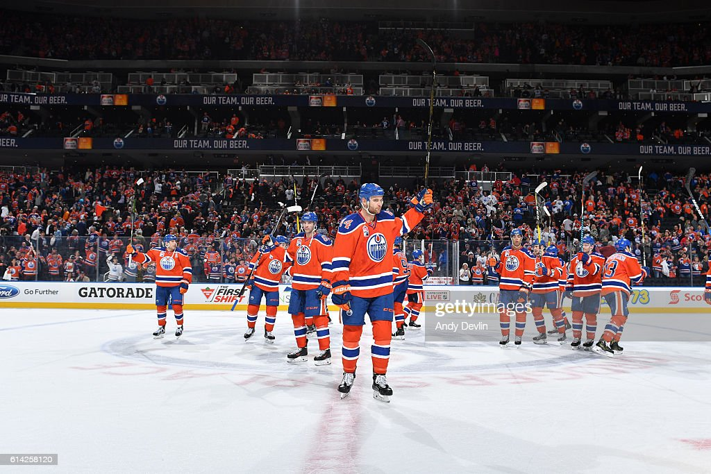 Players of the Edmonton Oilers salute the fans following the season opener against the Calgary Flames on October 12, 2016 at Rogers Place in Edmonton, Alberta, Canada