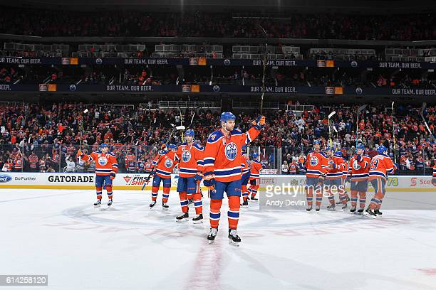 Players of the Edmonton Oilers salute the fans following the season opener against the Calgary Flames on October 12 2016 at Rogers Place in Edmonton...