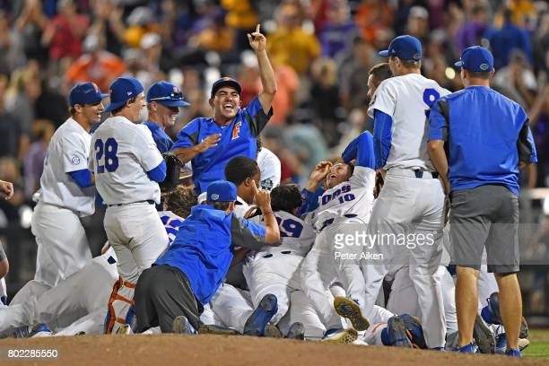 Players of the Florida Gators celebrate after defeating the LSU Tigers 61 to win the National Championship at the College World Series on June 27...
