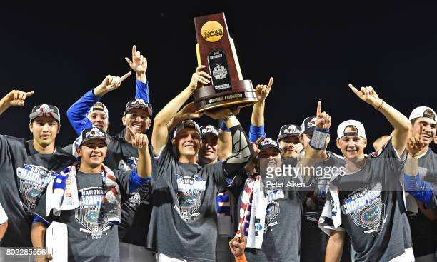 Players of the Florida Gators hold up the National Championship Trophy after defeating the LSU Tigers 61 at the College World Series on June 27 2017...