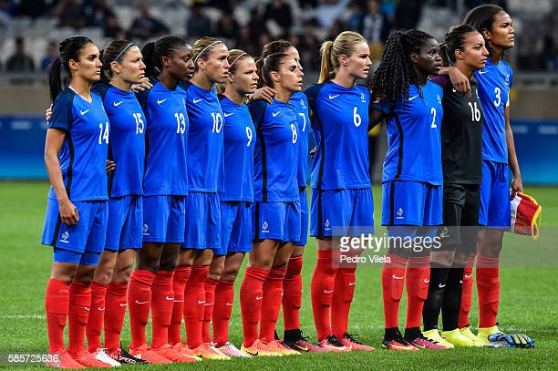 Players of the France listen to the national anthem prior to the Women's Group G first round match between France and Colombia as part of Women's...