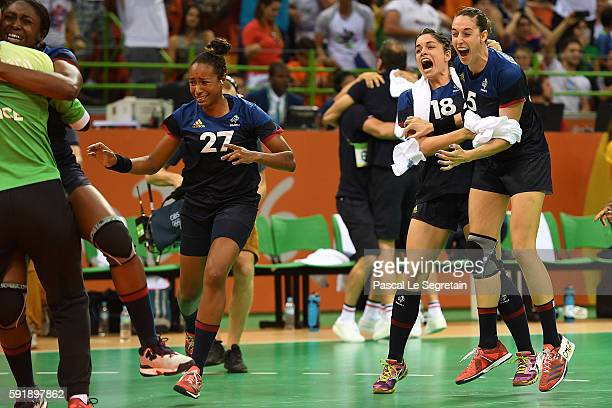 Players of the French Handball team celebrate their win and qualification for the final at the end of the women's semifinal handball match...