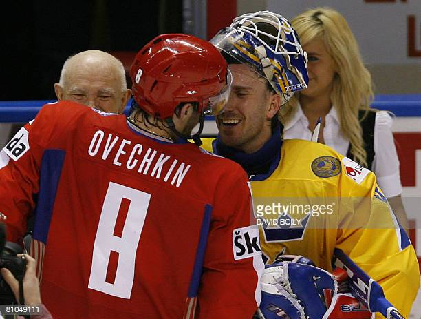 Players of the game Alexander Ovechkin of Russia and Henrik Lundqvist of Sweden shake hands after Russia's victory over Sweden during the...
