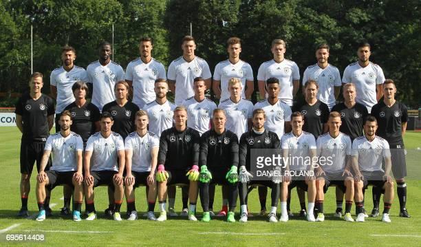 Players of the German national football team Germany's midfielder Kerem Demirbay defender Antonio Ruediger midfielder Sandro Wagner defender Niklas...