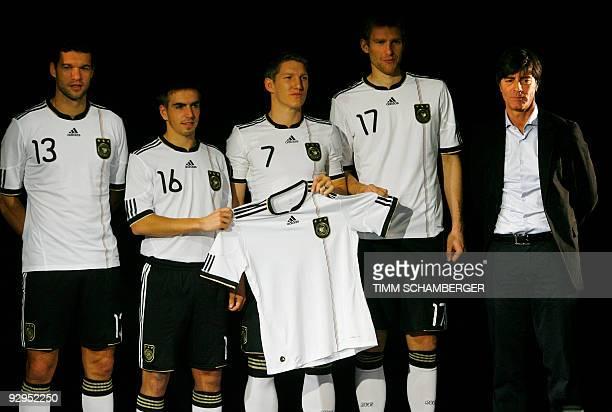 Players of the German national football team Michael Ballack Philipp Lahm Bastian Schweinsteiger and Per Mertesacker and head coach Joachim Loew pose...