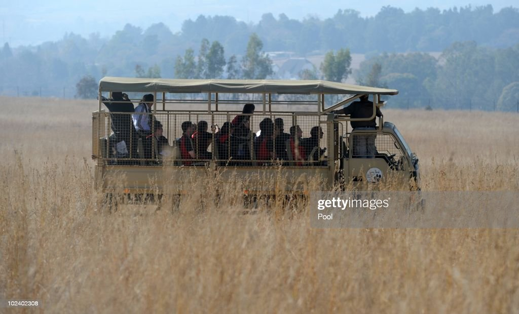 Players of the German national football team take photos while driving with a van during a visit of the Lion Park on June 25, 2010 in Lanseria, South Africa.