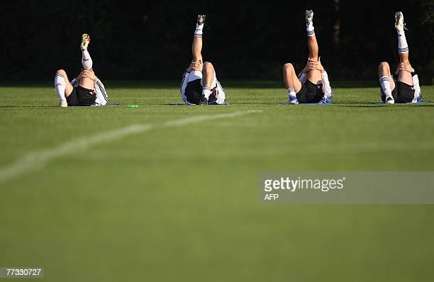 Players of the German national football team warm up during a training session 15 October 2007 in Munich southern Germany The German team prepares...