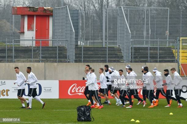 Players of the German national football team warm up during a training session ahead of their international friendly match against Spain at...