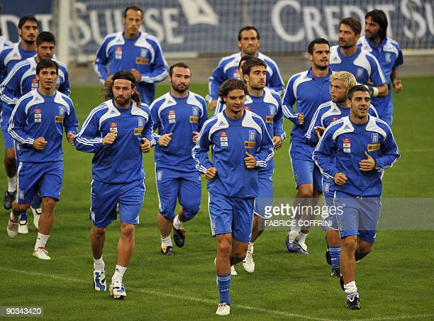 Players of the Greek national football team warm up during a training session on September 4 2009 at the St Jakob Stadium in Basel on the eve of a...