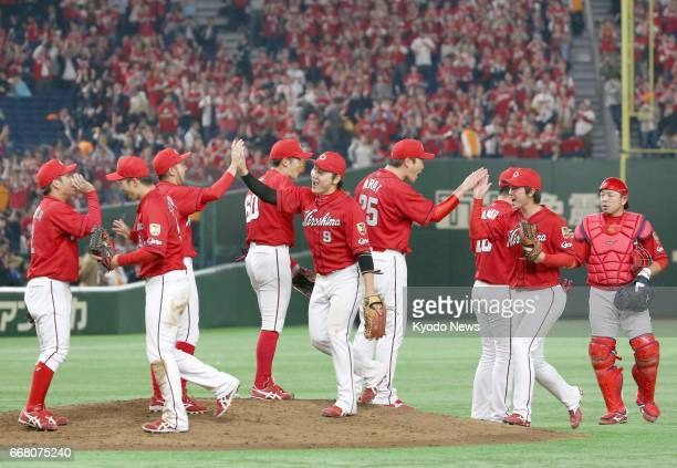 Players of the Hiroshima Carp celebrate after their 115 victory over the Yomiuri Giants at Tokyo Dome on April 13 2017 Hiroshima has 10 wins and one...