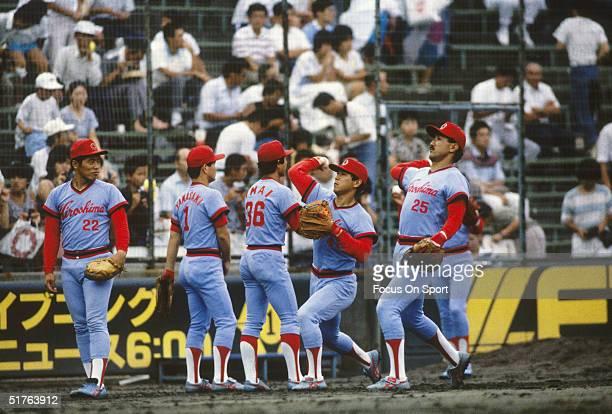 Players of the Hiroshima Carp practice throwing during warmup circa 1990's