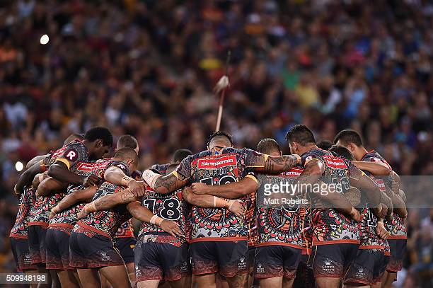 Players of the Indigenous All Stars huddle during the NRL match between the Indigenous AllStars and the World AllStars at Suncorp Stadium on February...