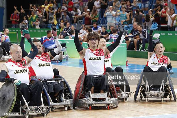 Players of the Japanese wheelchair rugby team celebrate after defeating France 5752 in a pool phase group B match at the Rio de Janeiro Paralympics...