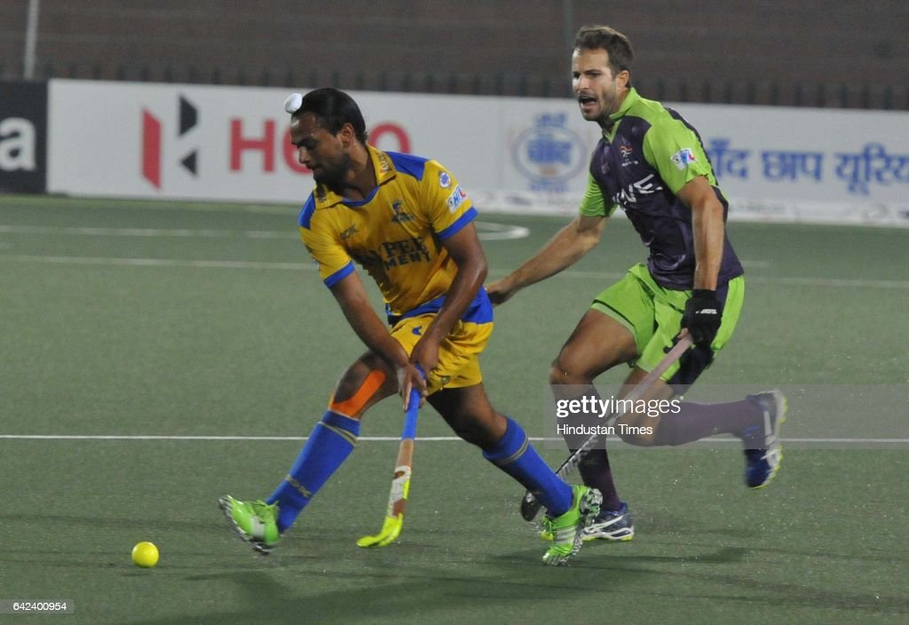 Players of the Jaypee Punjab Warriors and Delhi Waveriders playing the match during the Coal India Hockey India League 2017at the Hockey Stadium on...