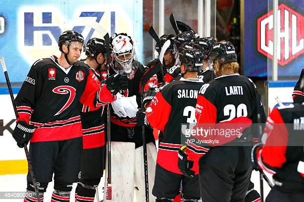 Players of the JYP Jyvaskyla celebrate a 20 win during the Champions Hockey League group stage game against the Kloten Flyers August 24 2014 in...