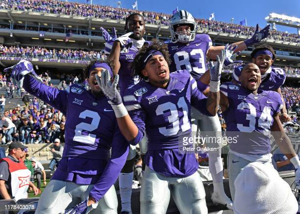 Players of the Kansas State Wildcats celebrate after beating the Oklahoma Sooners at Bill Snyder Family Football Stadium on October 26, 2019 in...
