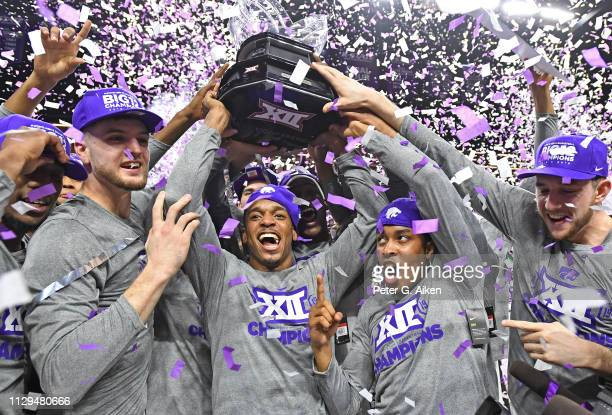 Players of the Kansas State Wildcats celebrate after wining the Big 12 Regular Season Championship on March 9 2019 at Bramlage Coliseum in Manhattan...