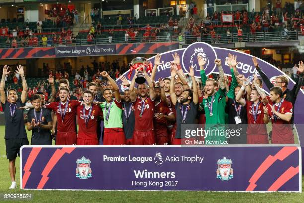 Players of the Liverpool FC celebrate with their trophy after the Premier League Asia Trophy final match between Leicester City FC and Liverpool FC...