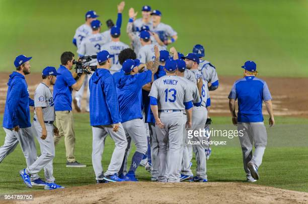 Players of the Los Angeles Dodgers celebrate after winning the first game in the series with no hits or runs against the San Diego Padres at Estadio...