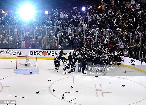 Players of the Los Angeles Kings leave the bench and celebrate with goaltender Jonathan Quick of the Los Angeles Kings after winning Game Six of the...