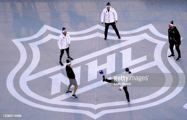 Players of the Los Angeles Kings warm up with a soccer ball prior to the 2020 NHL Stadium Series game between the Los Angeles Kings and the Colorado...