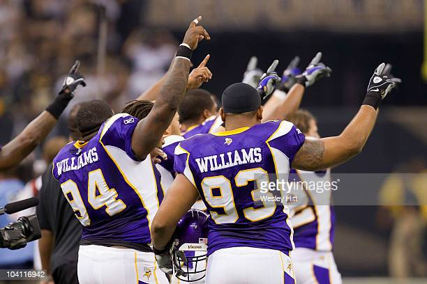 Players of the Minnesota Vikings signal with a finger in the air to show player unity before the season opener against the New Orleans Saints at the...