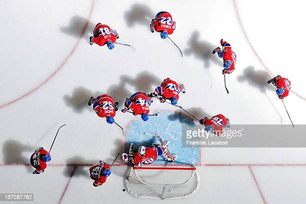 Players of the Montreal Canadiens gather around goalie Peter Budaj before the NHL game against the Washington Capitals on January 18, 2012 at the...