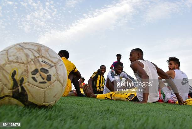 Players of the Nassara Agadez football club composed of Nigeriens and of migrants who attempt to reach Libya and Europe going through Agadez attend a...