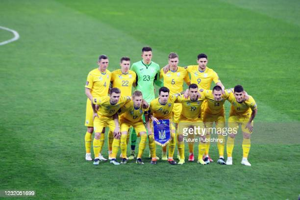 Players of the national team of Ukraine pose for a picture before the FIFA World Cup 2022 Qualifying Round Matchday 3 Group D fixture against...