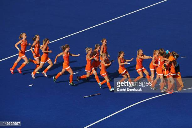 Players of the Netherlands celebrate after Ellen Hoog scored the winning penalty in the shootout after extra time during the Women's Hockey semifinal...