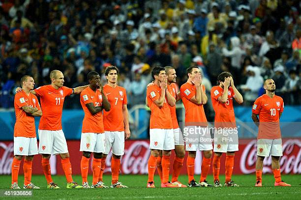Players of the Netherlands watch the penalty shootout during the 2014 FIFA World Cup Brazil Semi Final match between Netherlands and Argentina at...