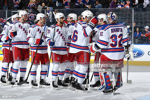 Players of the New York Rangers celebrate after winning the game against the Edmonton Oilers on November 13 2016 at Rogers Place in Edmonton Alberta...