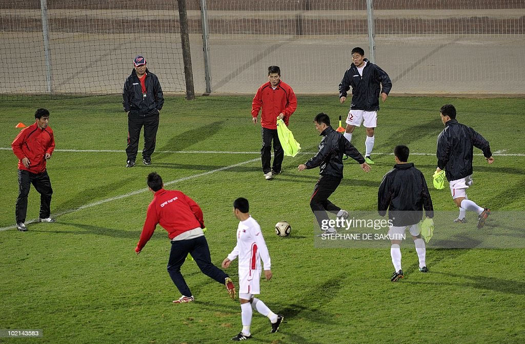 Players of the North Korea football team take part in a training session at Makhulong Stadium on June 16, 2010 in Tembisa. North Korea's official media on June 16 praised its team for a 'fierce' fight in their first World Cup match for 44 years, complimenting the players for their dogged performance against Brazil on June 15.