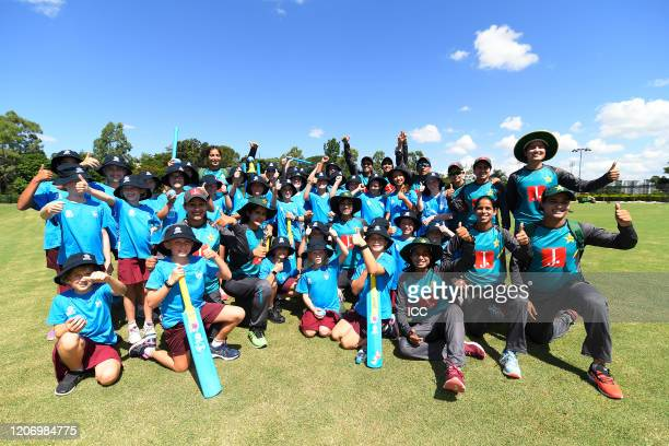 Players of the Pakistan national women's team pose for photos with young fans during the ICC Women's T20 Cricket World Cup Cricket 4 Good Clinic at...