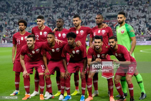 Players of the Qatar national tram pose for a team photo before the first game of the Gulf Cup between Qatar and Iraq at the Khalifa International...