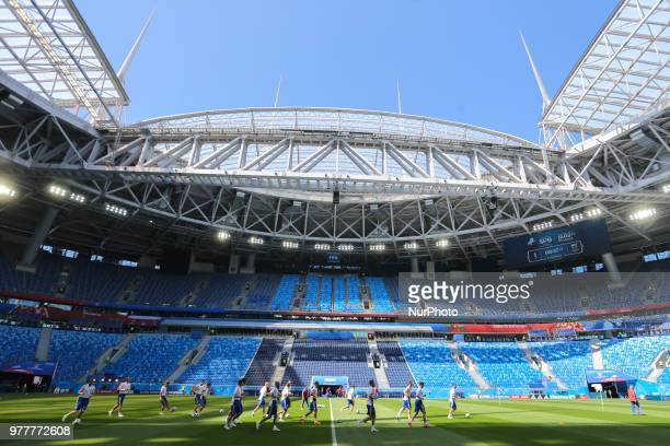 Players of the Russia national football team takes part in a training session at Saint Petersburg Stadium in Saint Petersburg on June 18 ahead of a...