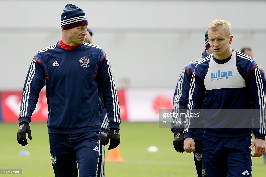 Players of the Russia national soccer team Vasiliy Berezutskiy (L) and Igor Smolnikov (R) seen during training session of Russian national soccer team at Arena Khimki in Russia, Moscow before UEFA Euro 2016 qualifying Group G soccer match against Montenegro national soccer team.