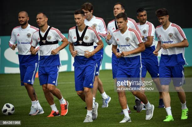 Players of the Russian national football team attend a training session in Novogorsk outside Moscow on June 26 ahead of the 2018 World Cup Round of...