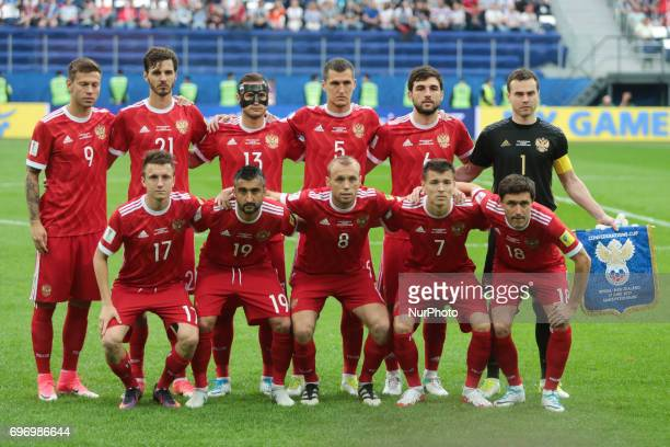 Players of the Russian national football team vie for the ball during the 2017 FIFA Confederations Cup match first stage Group A between Russia and...