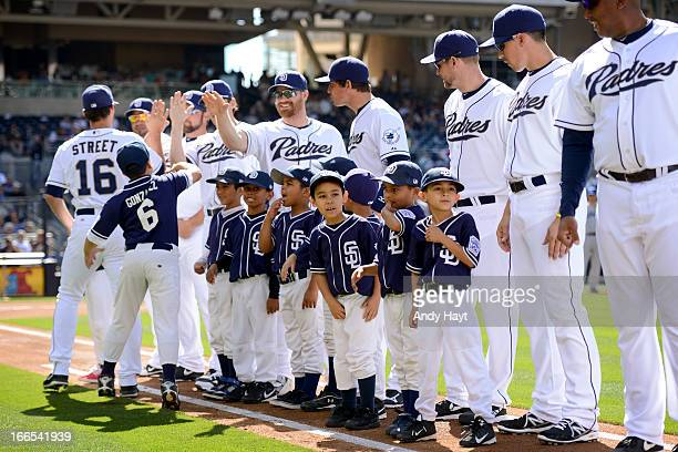 Players of the San Diego Padres greet Little League players on the field during the pre game line up on Opening Day against the Los Angeles Dodgers...