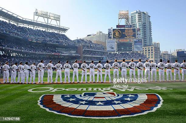 Players of the San Diego Padres line up at first base on Opening Day prior to the game against game against the Los Angeles Dodgers at Petco Park on...