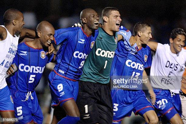 718de85fef Players of the Sao Caetano celebrate with goal keeper Silvio Luiz after  finishing the penalties against