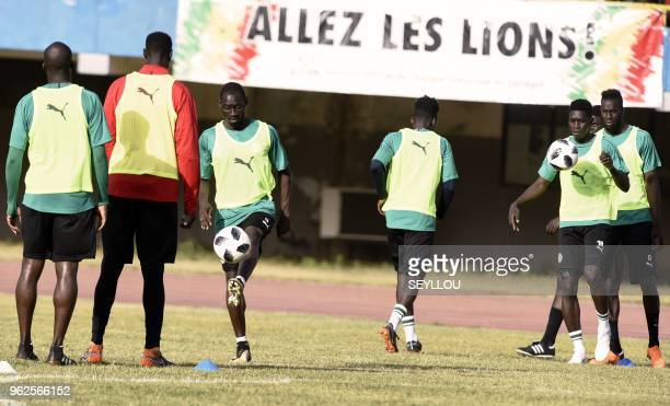Players of the Senegal national football team nicknamed the Lions of Teranga take part in a training session at the Leopold Sedar Senghor stadium in...