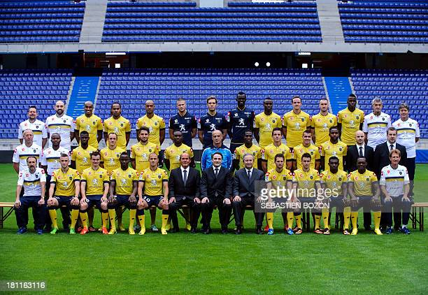 Players of the Sochaux French league L1 football club pose for a group picture on September 19 at the Auguste Bonal stadium in Montbeliard eastern...