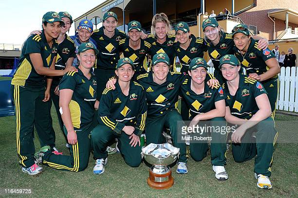 Players of the Southern Stars pose for a photo with the Rose Bowl Trophy after game three of the women's one day international series between...